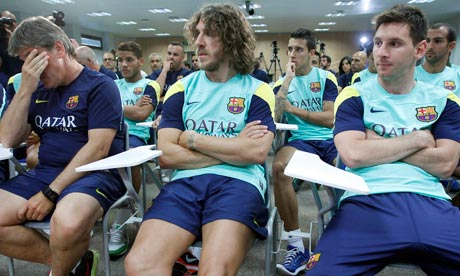 Jordi Roura, Carles Puyol and Lionel Messi at Friday's press conference. Photograph: Albert Gea/Reuters