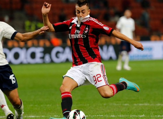 AC Milan's El Shaarawy shoots and scores his second goal against Cagliari during their Serie A soccer match at San Siro stadium in Milan