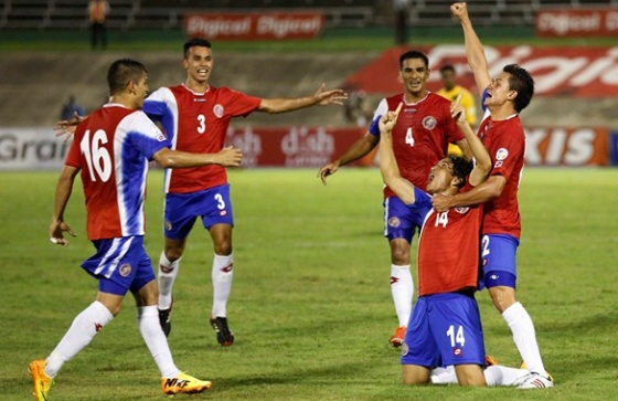 Costa Rica's Brenes celebrates his goal against Jamaica with teammates during their 2014 World Cup qualifying soccer match in Kingston