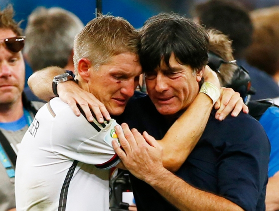 Germany's Schweinsteiger embraces coach Joachim Loew as they celebrate their win against Argentina after their 2014 World Cup final at the Maracana stadium in Rio de Janeiro